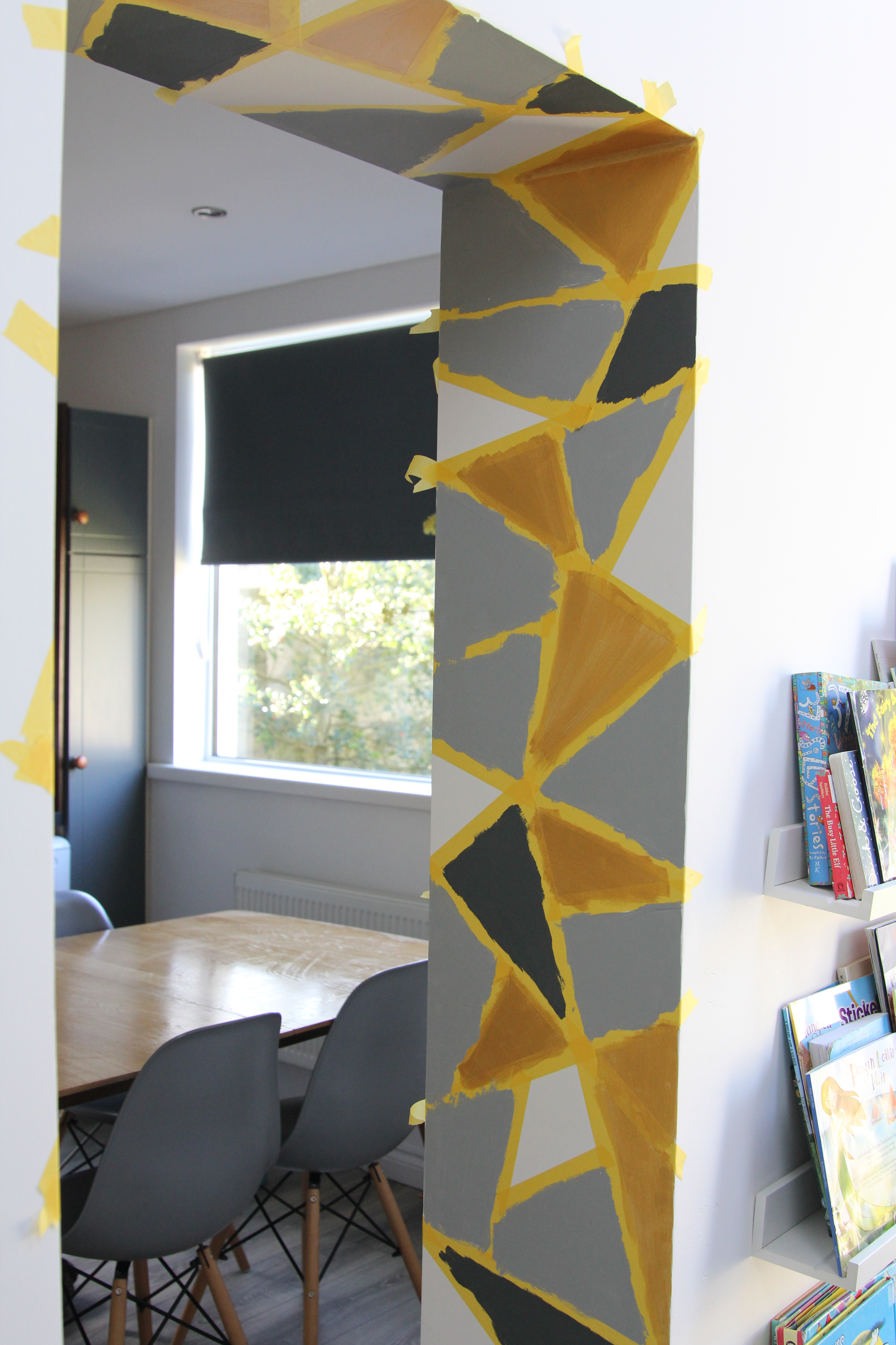 Paint and frog tape on geometric wall