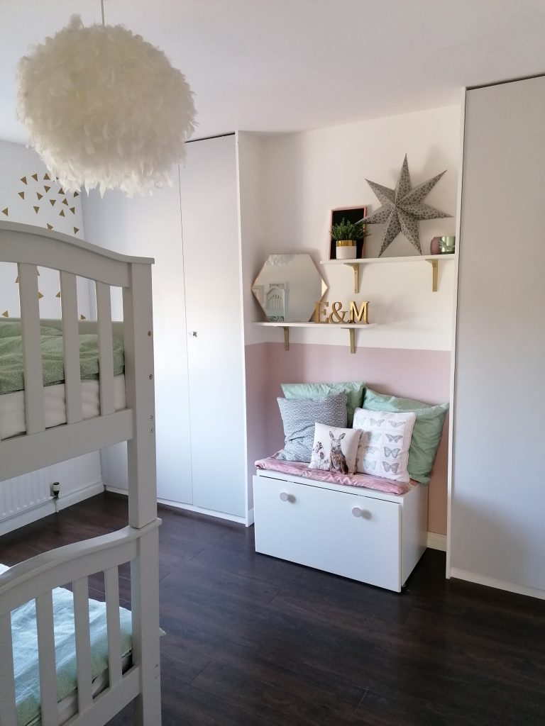 Completed childrens reading nook and bunkbeds in girls bedroom