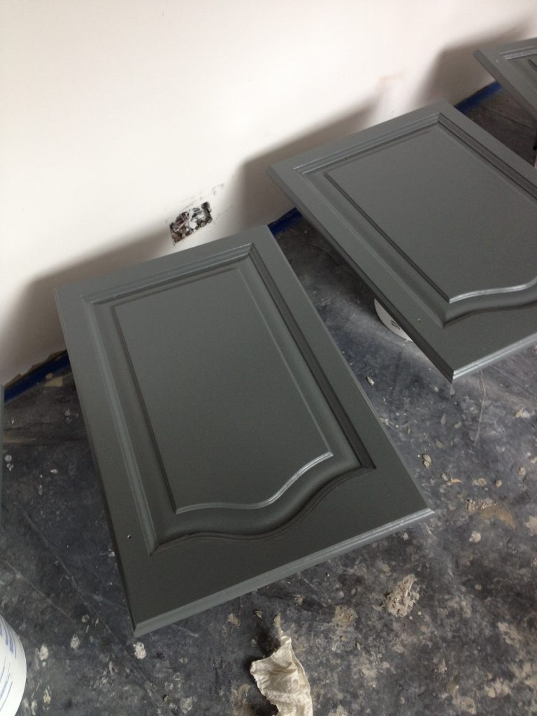 Freshly painted dark grey kitchen cupboards