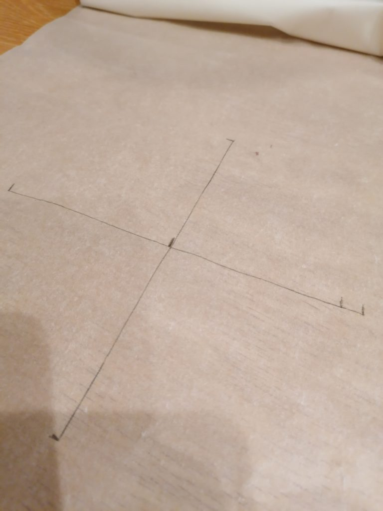 measured cross on parchment paper