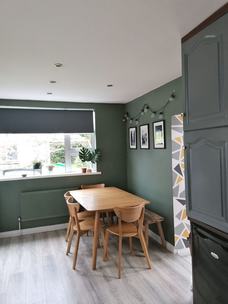 Green walls and green radiator painted to match