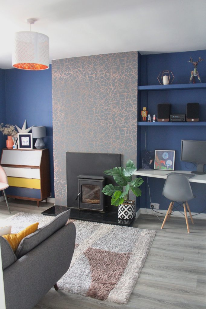 Desk, chair in blue room with grey and copper wallpaper. Woad blue paint Little Greene