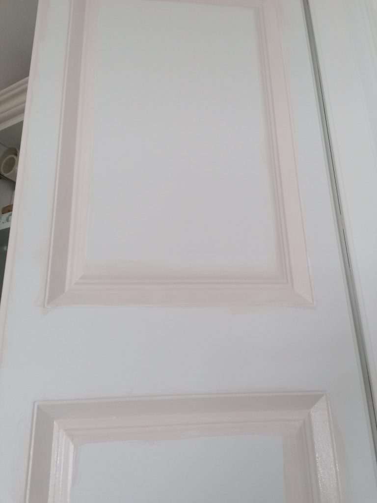 pink paint on laminate door