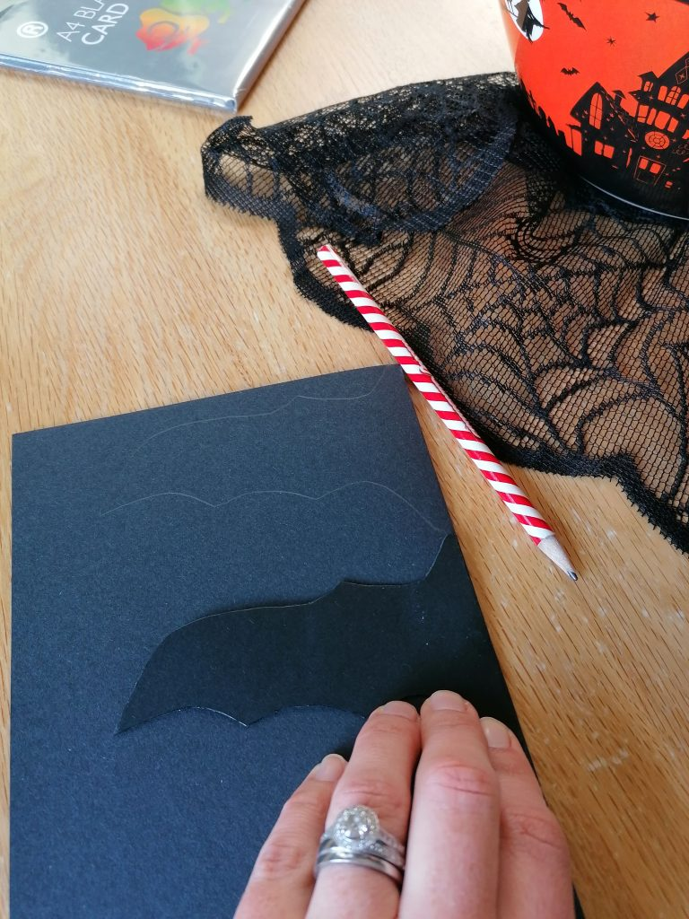 Drawing out black bat template on paper card