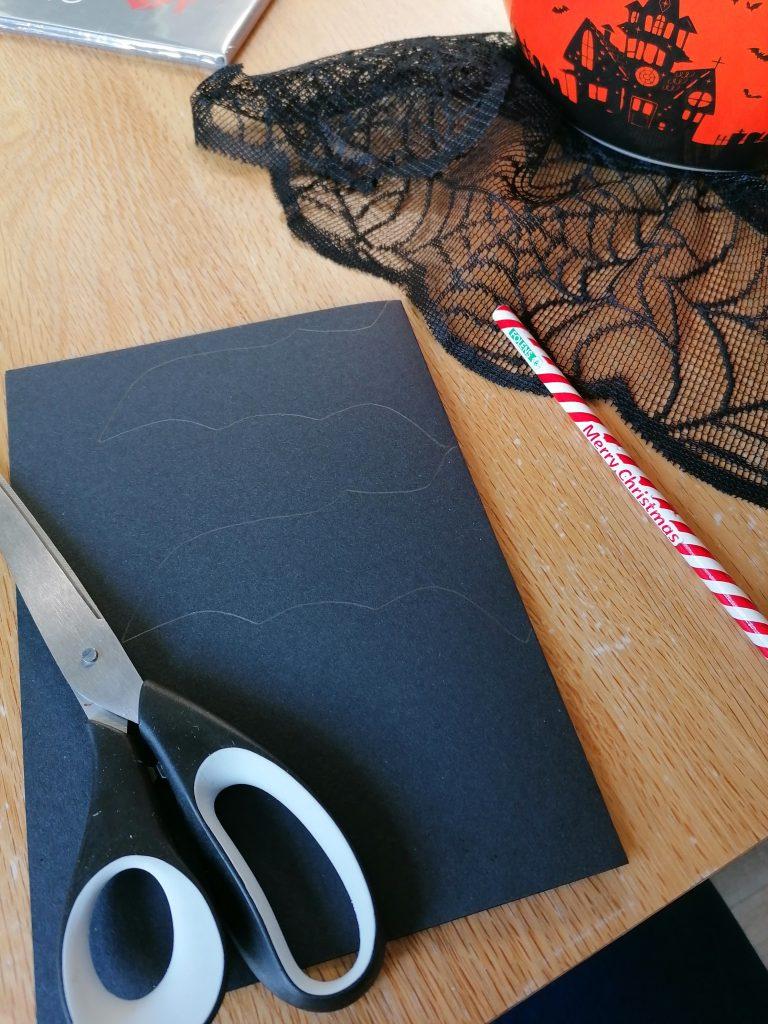 black card and scissors