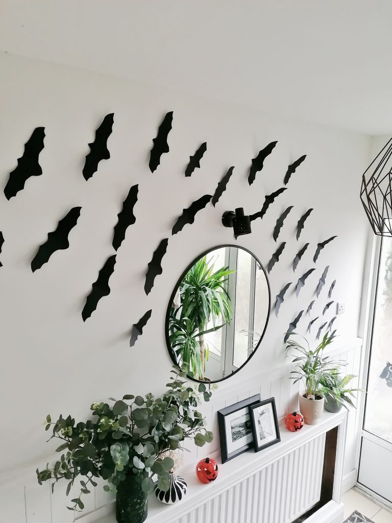 Hallway with black paper bats for Halloween