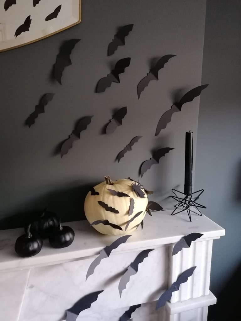 Black bats on sitting room fireplace and wall