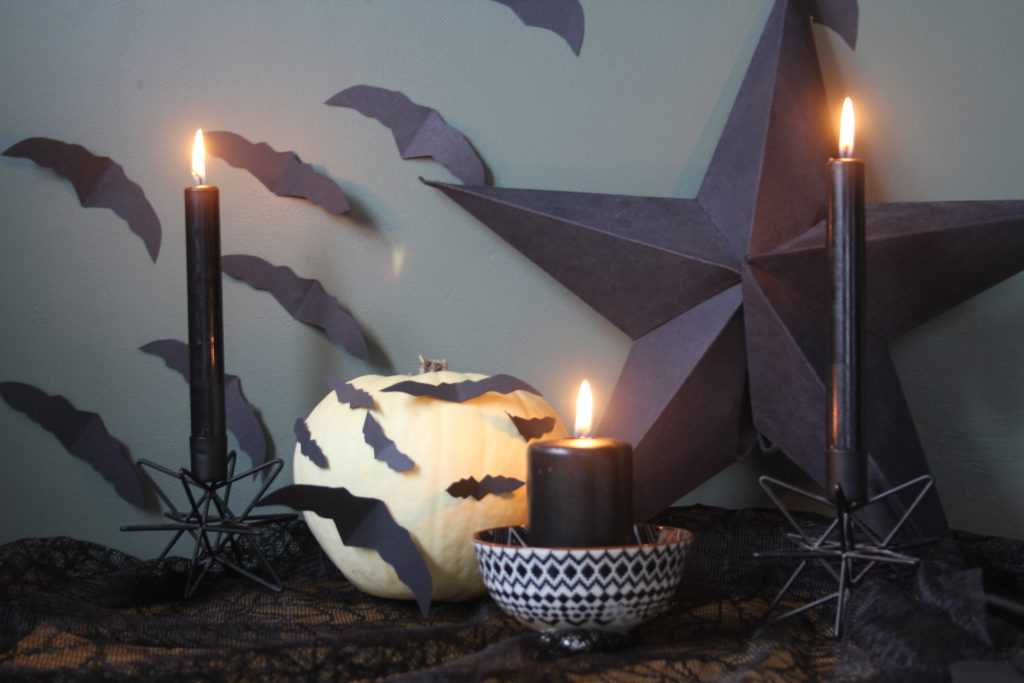 Spooky Black candles and black bats used as Halloween decorations
