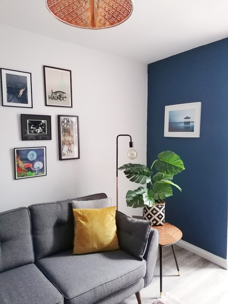 Gallery wall is a quick update for your home for Spring in our Blue and White Living Room
