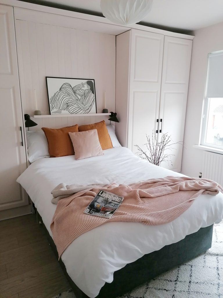 update your home for spring with white bed clothes and pink walls