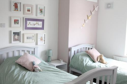 Girls bedroom pink paint is Powder Room from Dulux