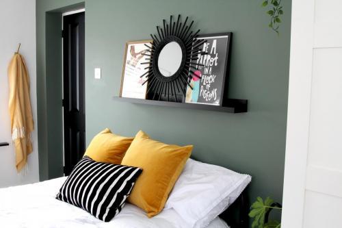 Valspar Puddle Jumper green paint, yellow H&M cushions, white duvet cover, black IKEA shelf