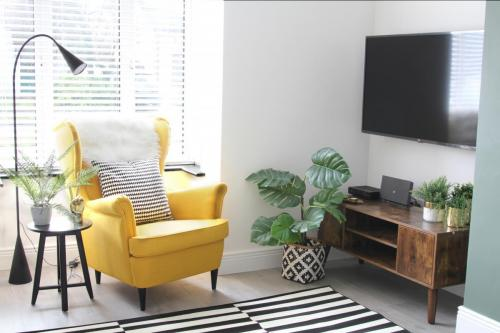 Yellow IKEA Chair and black and white rug
