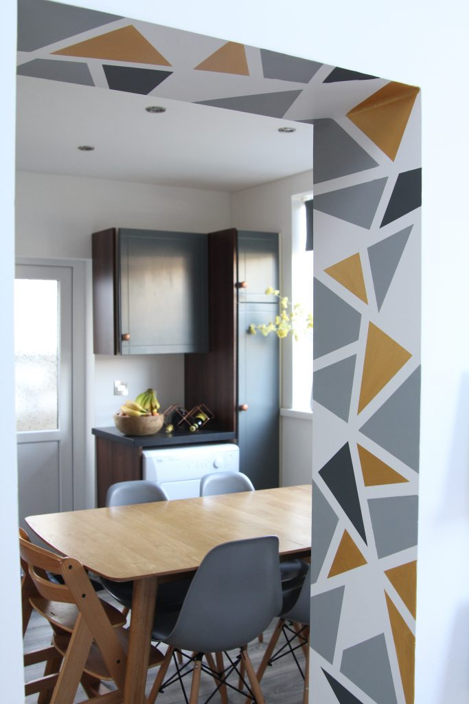 Update your home with geometric shapes on the wall to feel happier in your home.