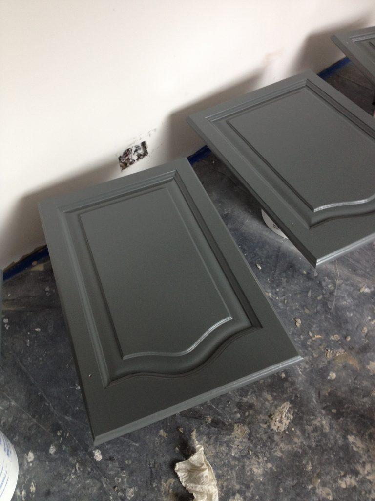 Freshly painted dark grey kitchen cupboards