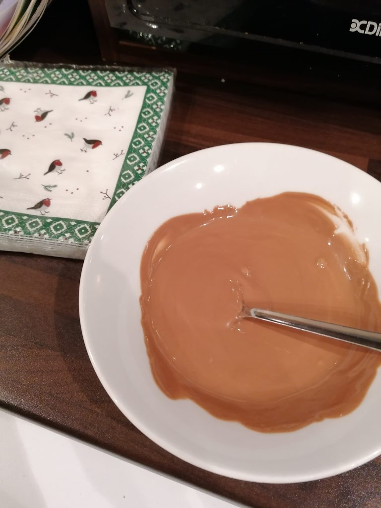 bowl of melted chocolate to assemble the chocolate rice crispy tree