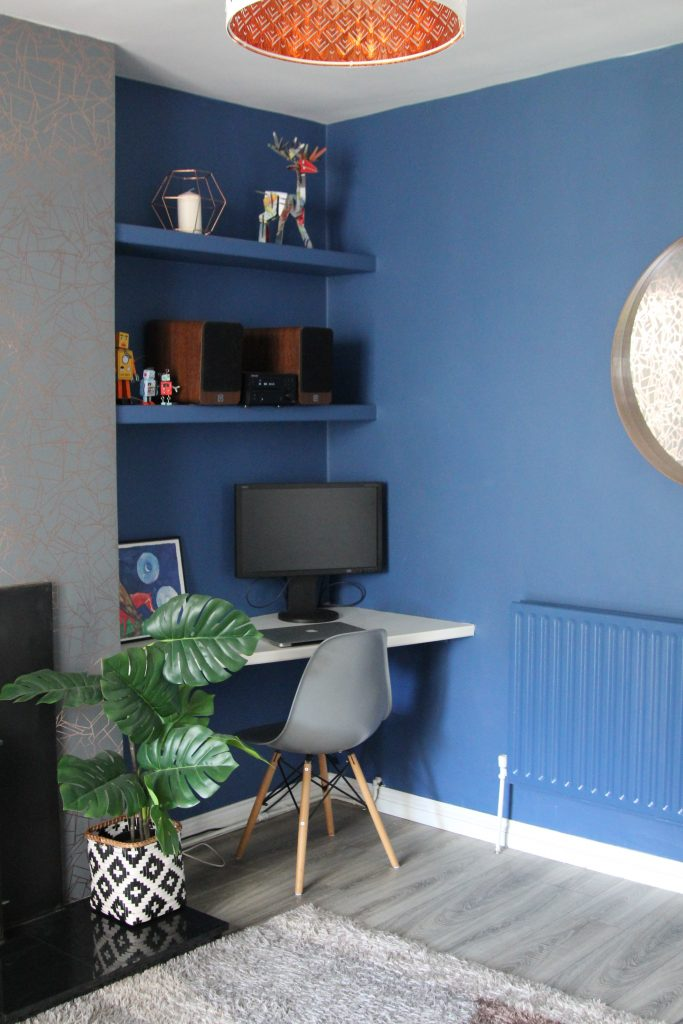 Blue walls and blue radiator painted in Woad from Little Greene