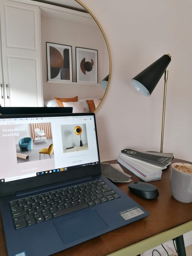Pink walls Valspar Peaceful Soul. Home office desk set up, laptop, table, lamp and mirror