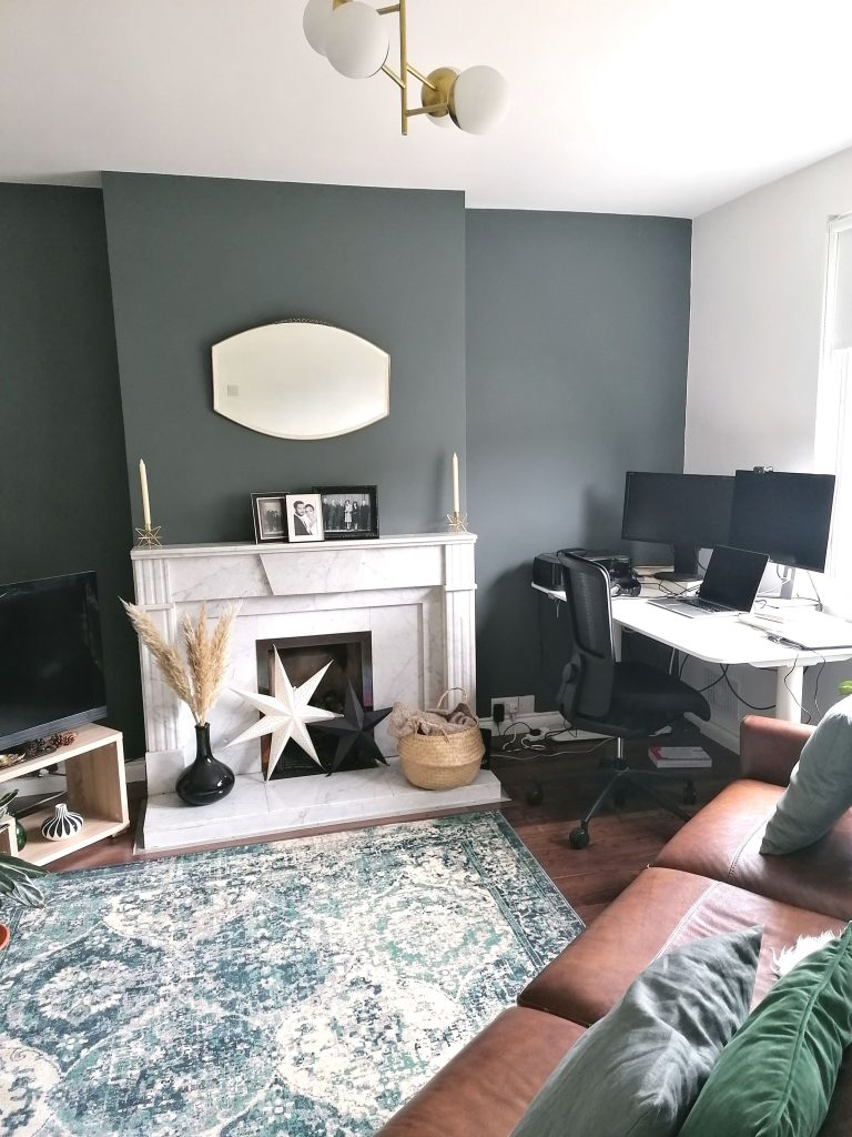 Sitting room home office. Desk facing window and tucked into corner of the room