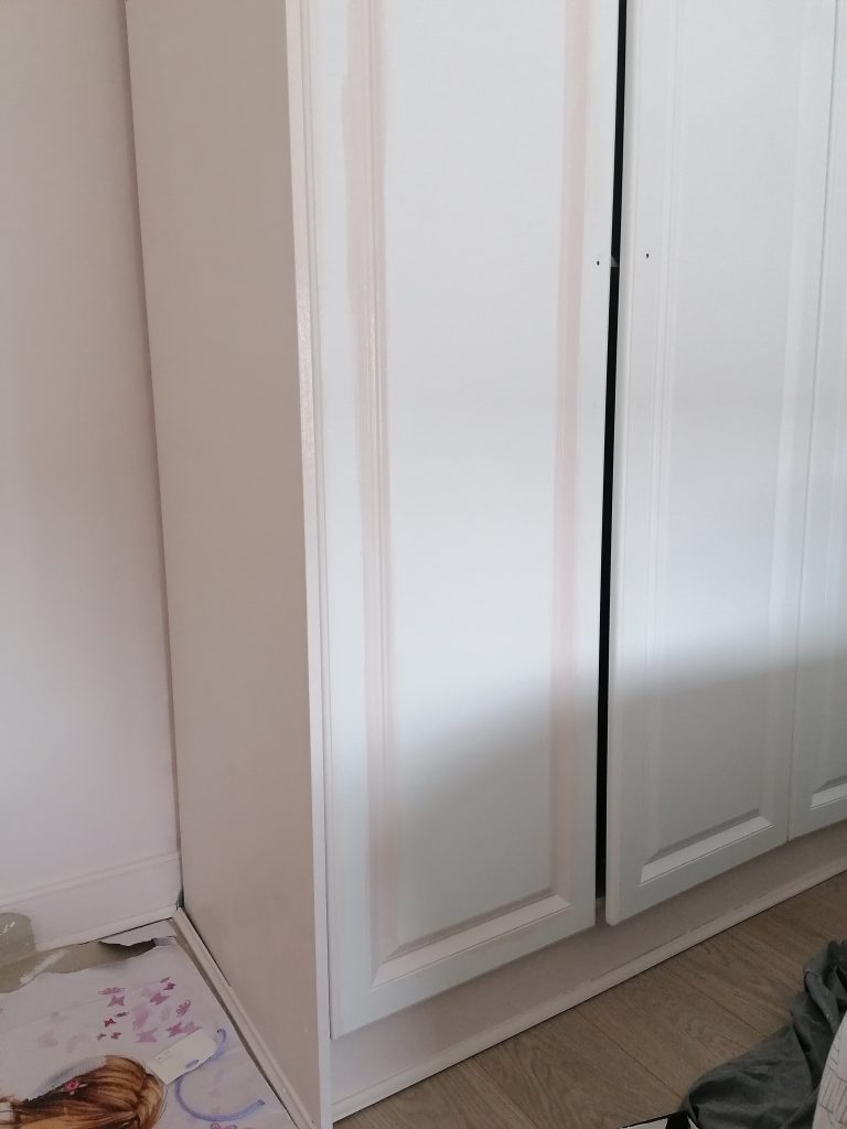 pink paint on laminate wardrobes in grooves