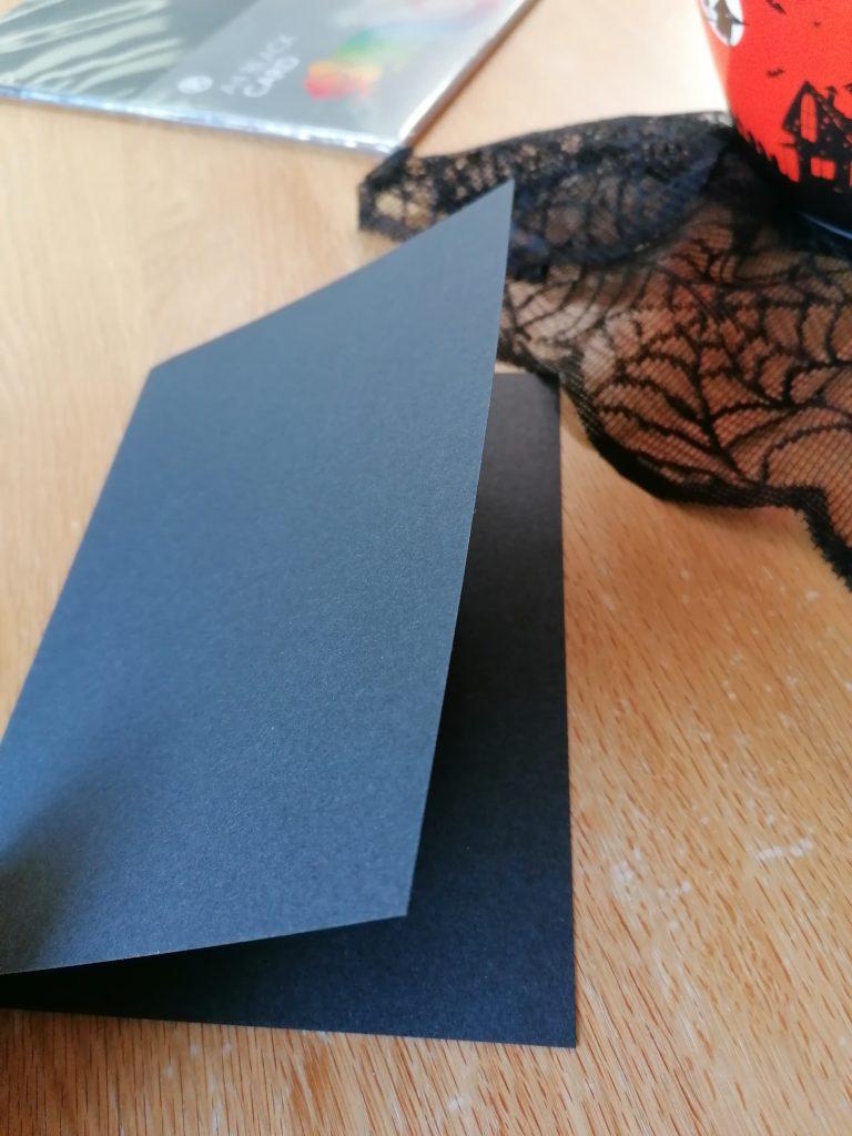 Black card folded in half