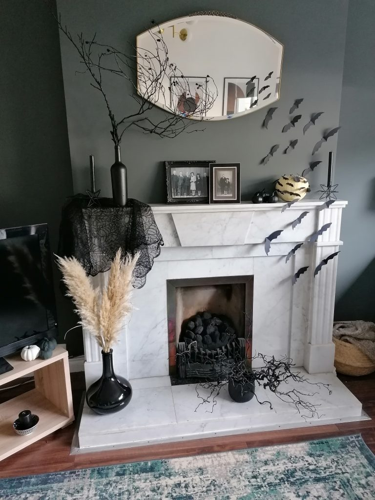 Halloween decorated mantelpiece featuring spooky DIY decorations