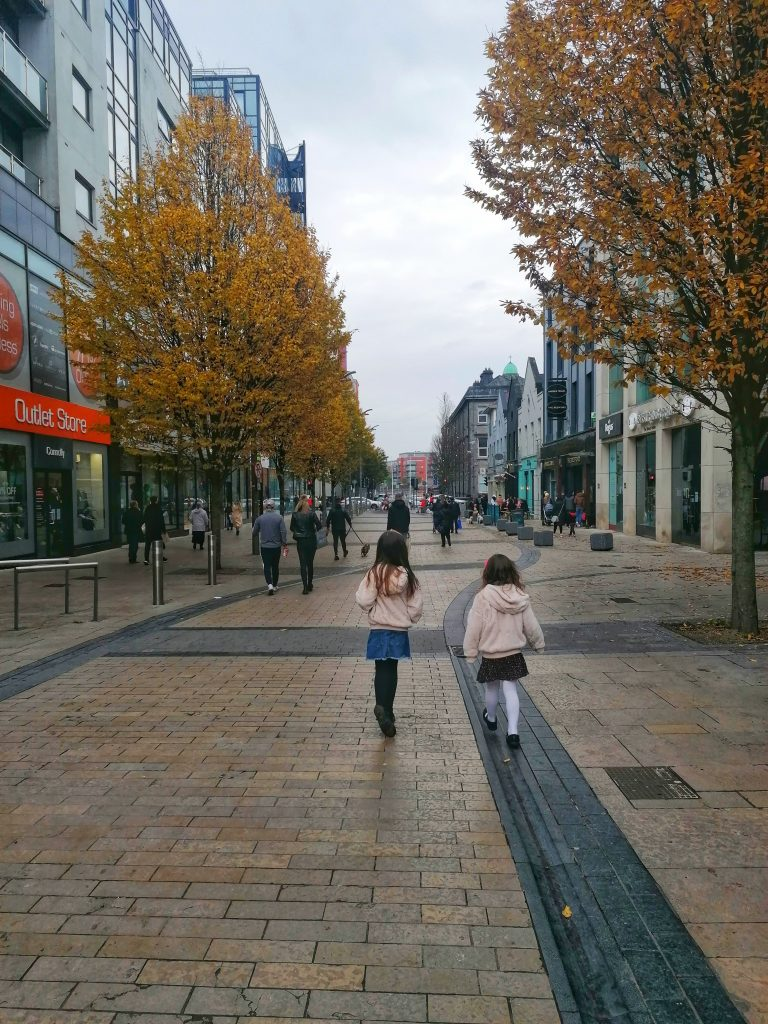 Photo of Limerick city - Bedford Row - two girls walking - photo by Style At No. 5 - Limerick Gift Guides