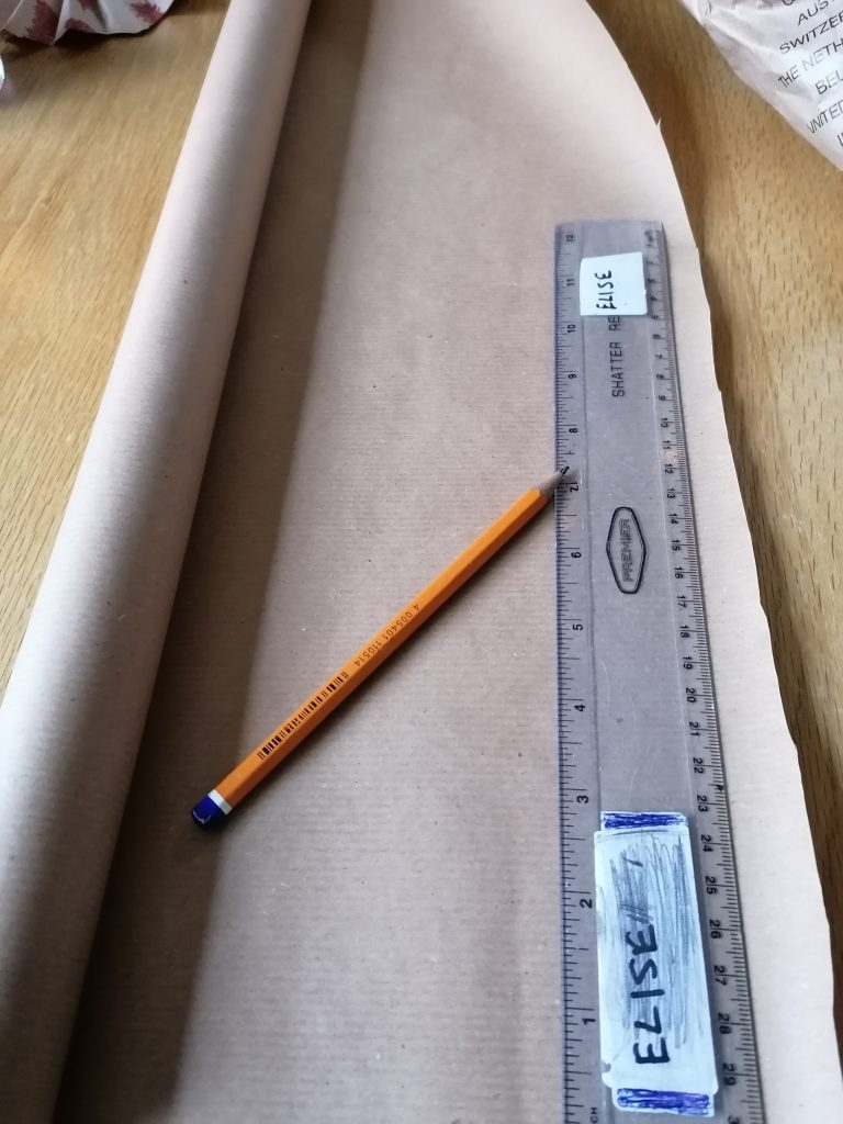 paper, pencil and ruler to draw out your paper stars