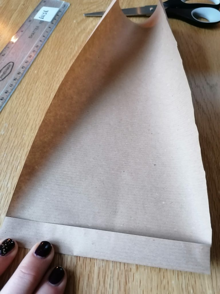 folding the paper to make a fan