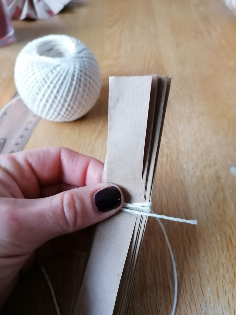 Folded paper and tied in the middle with string