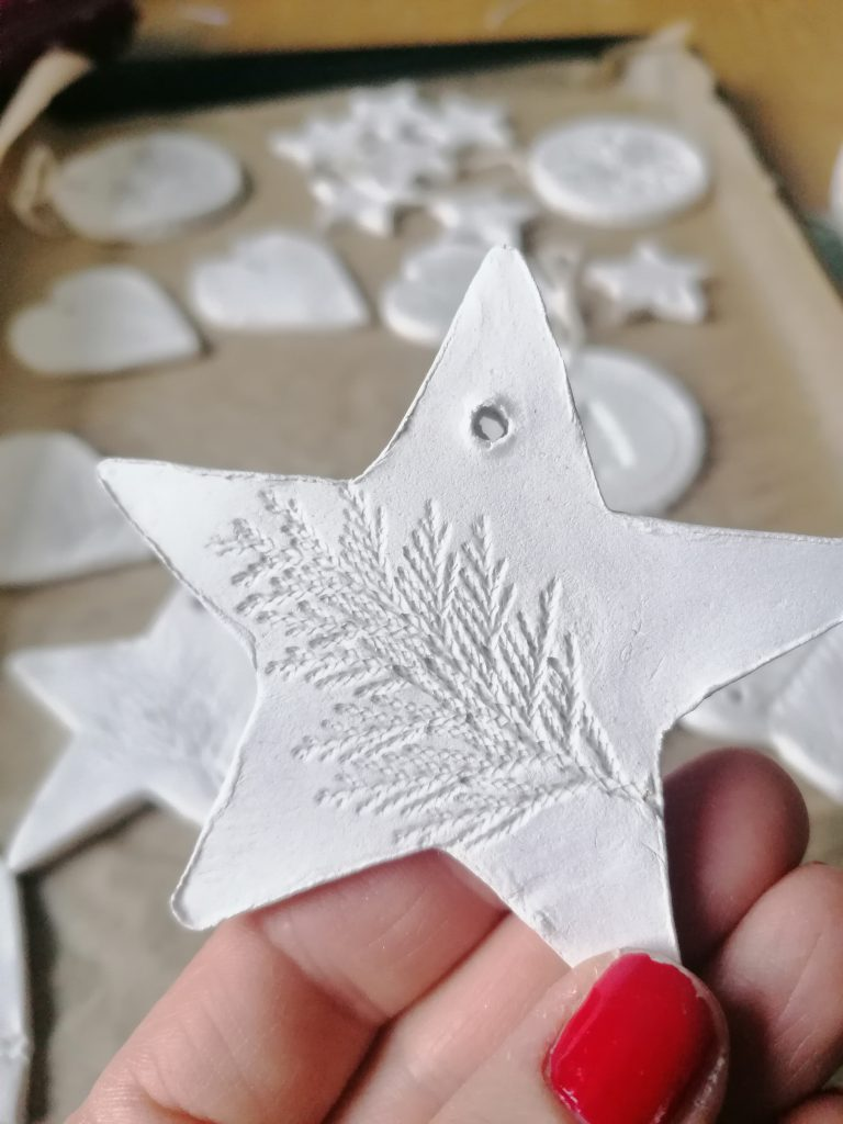 Dried simple air dry clay star decoration with hole in it for string