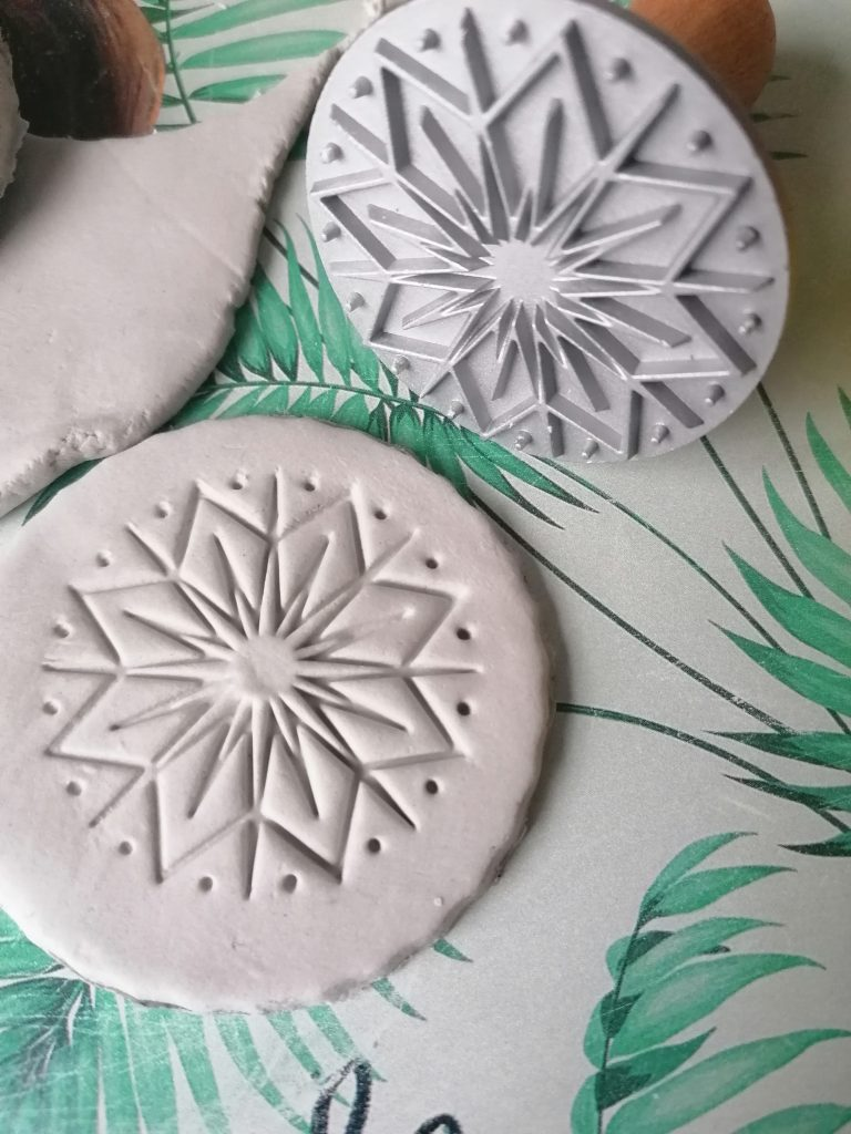 stamped imprint from stamper onto air dry clay