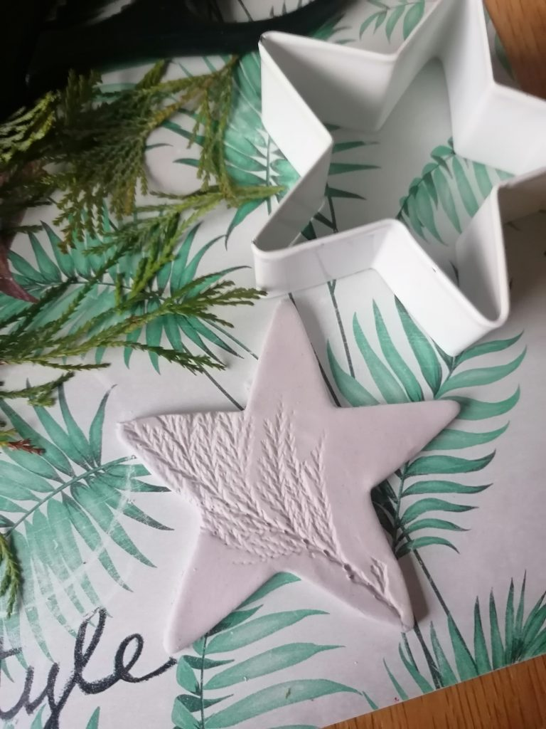simple air dry clay star decoration with imprint of leaves