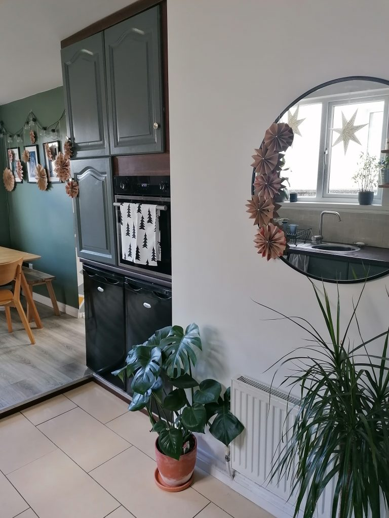 paper stars around mirror in kitchen