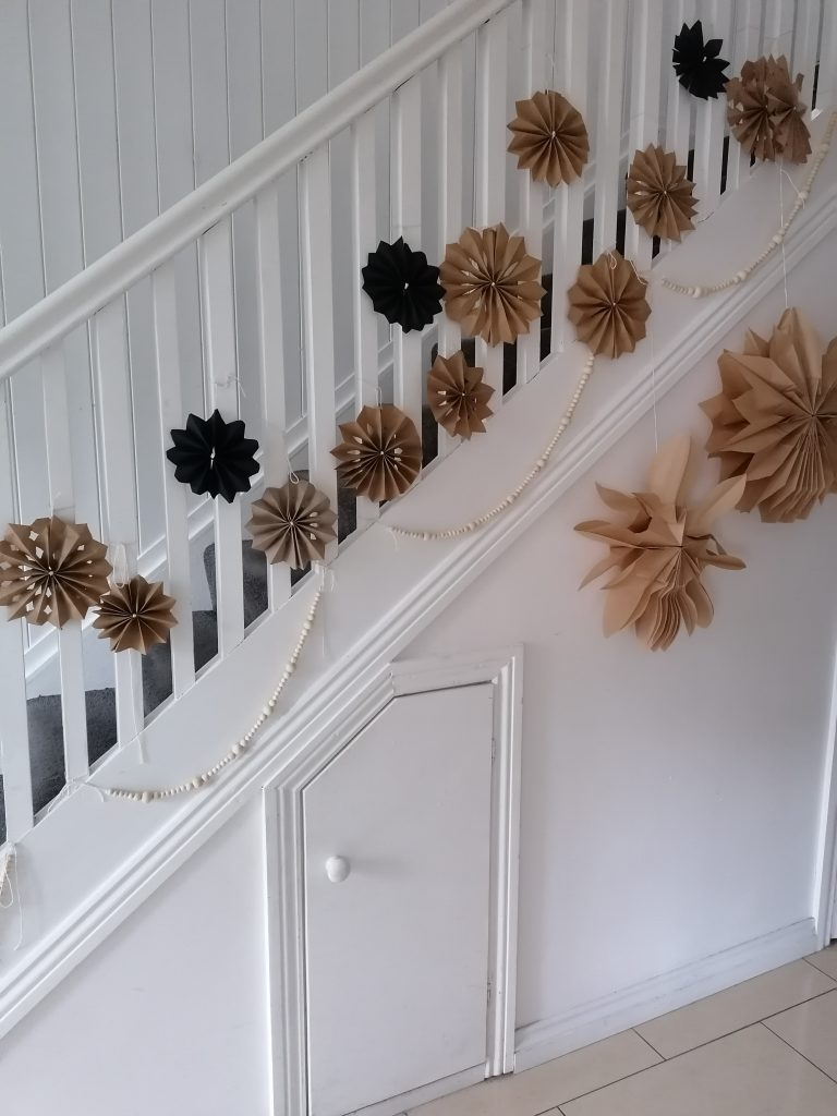 paper stars hanging from banisters