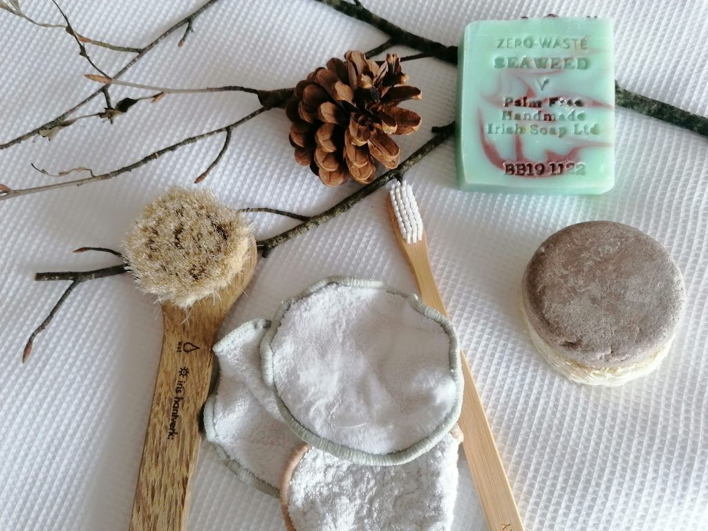 Sustainable beauty products on a white background. Photo taken by Celine Gill