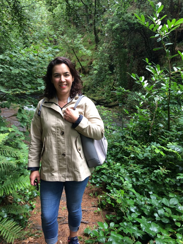 Celine Gill, Interior Designer, Style At No.5 Interior Design standing in a forest surrounded by greenery