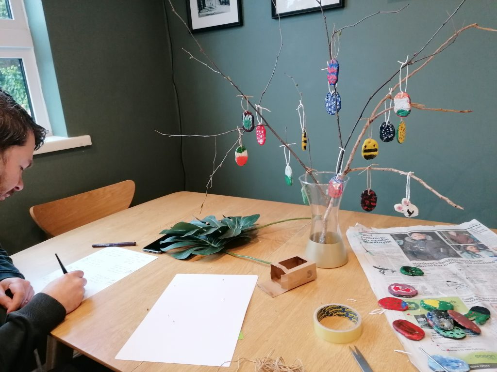 Kitchen table and Easter tree and writing out easter egg hunt clues