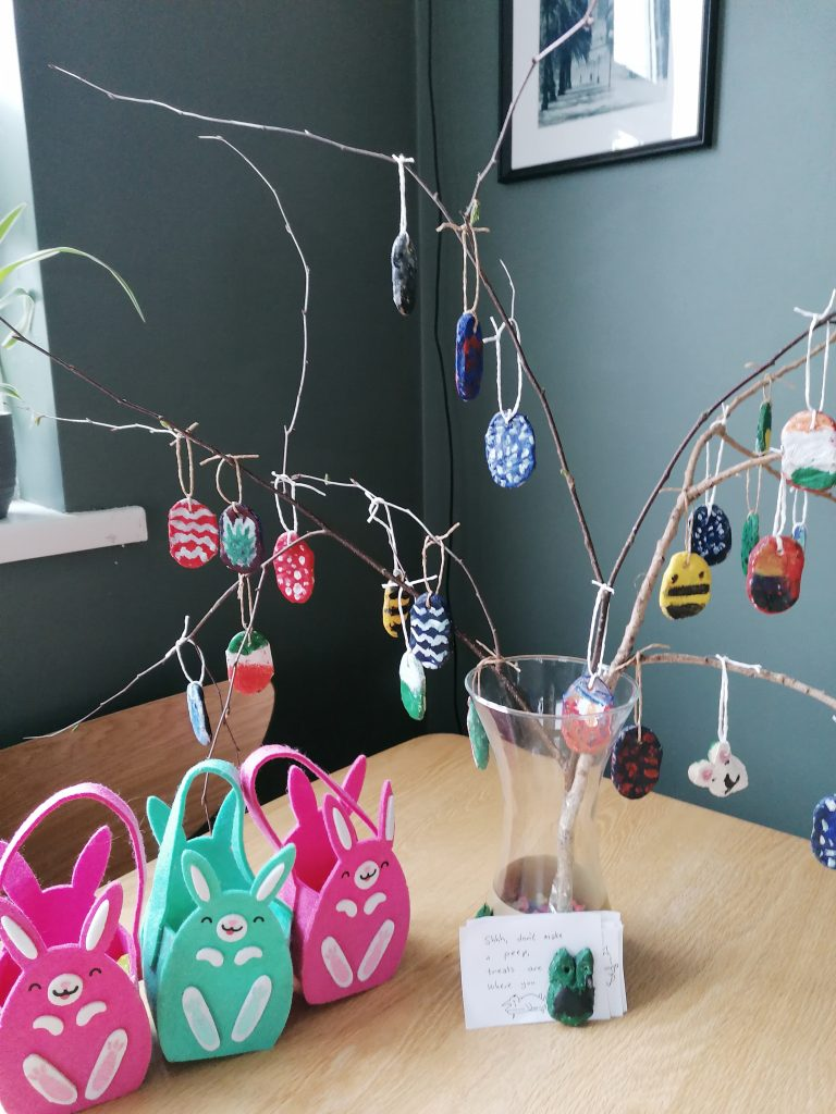 DIY tree with foraged branches and hanging Easter egg decorations made out of salt dough