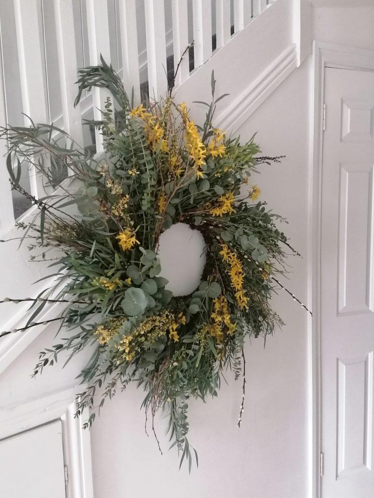 Easter wreath in yellow, green foliage