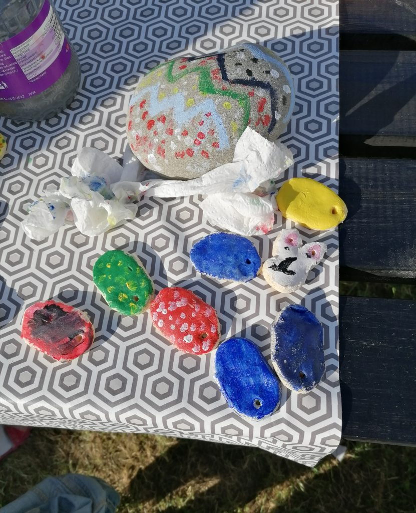 painted easter decorations and painted rock