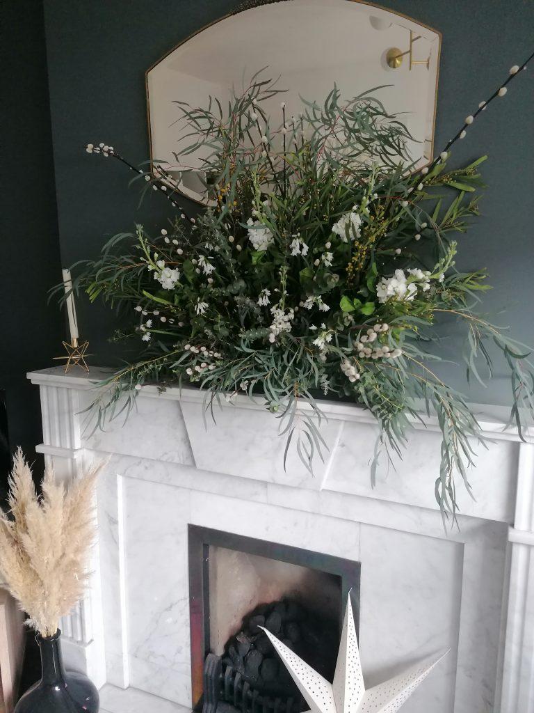 Easter Spring flower arrangement on mantelpiece