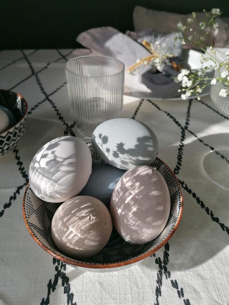 dappled light on Easter eggs on table