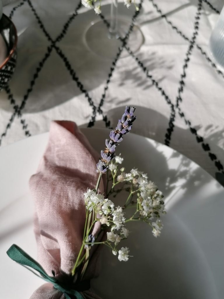 Close up shot of pink linen napkin and lavender and baby's breath